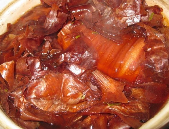 boiled bacon in a bag of onion peel