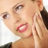 Как уменьшить зубную боль народными средствами