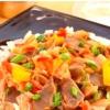 Куриные желудки с беконом и овощами