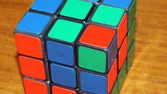 Как профи собирают кубик рубика за считанные минуты