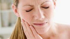 Как успокоить больной зуб