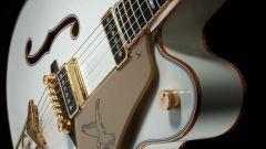 Как опустить струны на гитаре