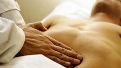 Почему болит живот и спина
