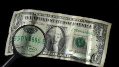 Как определить фальшивые доллары