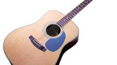 Как менять струны на акустической гитаре