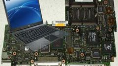 How to find a motherboard on a laptop