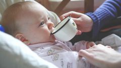 How to teach baby to drink from a mug