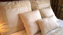 Как стирать пуховые подушки
