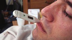 Как мерить температуру во рту
