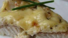 Как приготовить рыбу, запеченную под молочным соусом