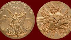 How many grams of gold in Olympic medals