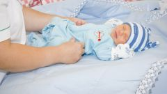 What to dress a newborn baby in the first days of stay at home