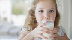 At what age a child can be given fresh cow's milk
