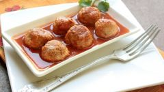 Juicy hedgehogs with rice in a creamy tomato sauce