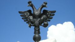 Why is the Russian coat of arms double-headed eagle