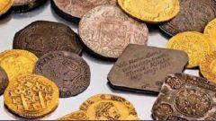 Где и когда появились первые монеты с изображением