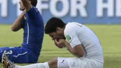 Как ФИФА наказала Суареса за укус