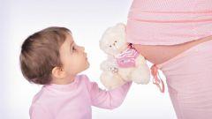 Почему принято трогать живот беременной