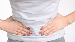 Почему болит живот перед месячными