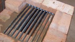 Grate as an integral element of the furnace