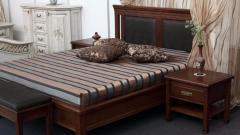 Какие кровати лучше: железные или деревянные