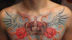 Что означает татуировка -  корона с крыльями?