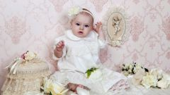 How to choose a christening dress for girls