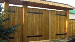 Как сделать и установить деревянные ворота