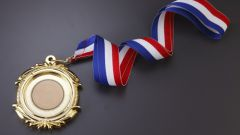 How to pin a medal on him