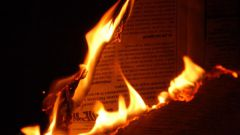 The temperature at which paper ignites