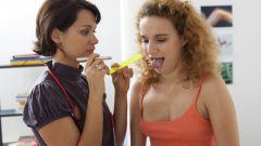 Причины и лечение желтого налета на языке