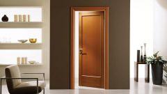 Какие материалы используют в качестве покрытия для бюджетных дверей
