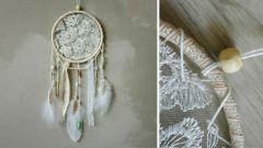 Lace dream catcher with their hands