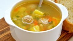 Soup with rice, vegetables and meatballs