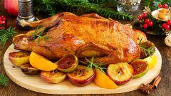 Как запечь утку в духовке с яблоками и апельсинами