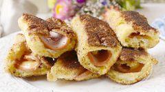 Рулетики из хлеба с сыром и колбасой: быстрый рецепт сытной закуски