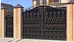 Железные ворота - эстетичный и безопасный вариант