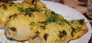 Кальмары, фаршированные рисом, овощами и колбасками