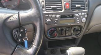Как снять магнитолу с Nissan Almera