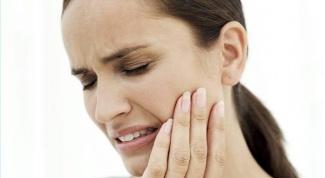 Почему опухает щека