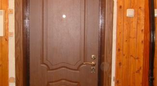 Как отделать входную дверь