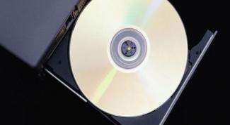 Как извлечь диск из дисковода