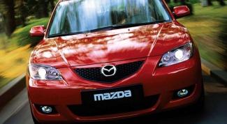 Как снять бардачок на Mazda