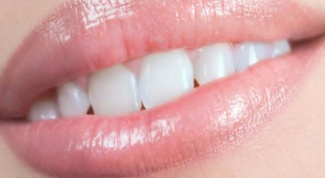 How to get rid of the black plaque on the teeth
