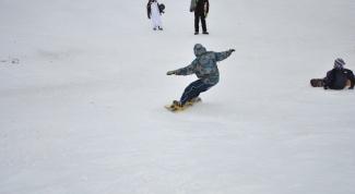Как надевать сноуборд