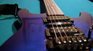 How to adjust an electric guitar