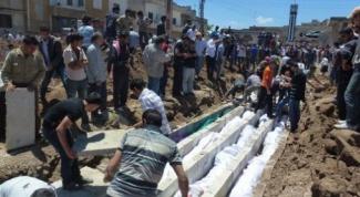 Кто ответит за трагедию в сирийском городе Хуле