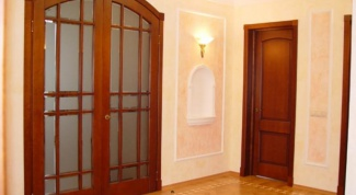 Interior doors of wood: advantages, installation, repair