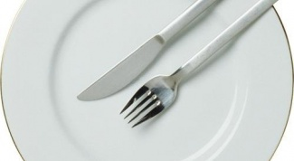 As you put your fork on the table: teeth up or down?