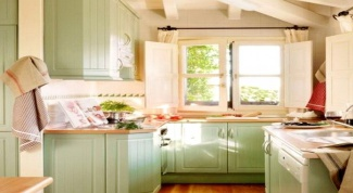 The kitchen is in the pistachio color